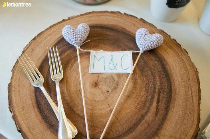 The home made cake stand with the cake topper.  Check out the engraving on the forks.