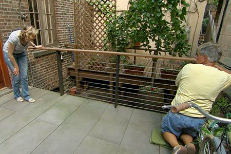 This Old House general contractor Tom Silva installs a cable railing on a deck in Greenwich Village, New York.
