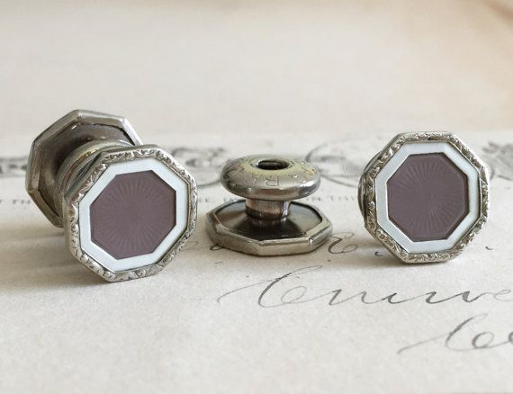 A handsome pair of 1920s snap Stag Brand cufflinks. A classic art deco design features an embossed purple-gray celluloid center set within a silver toned engraved decorative octagon border. The cuff links are appropriate for casual, business or formal wear.  These are from the 1920s and are in excellent shape with no chips, scratches or damage. A few minor imperfections as you would find with most vintage jewelry but not noticeable unless you inspect closely. The snap mechanism is in good…
