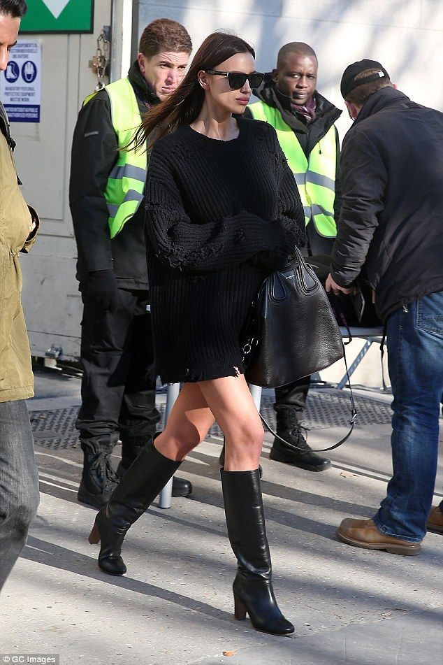 Jump to it:Striding forward in a pair of knee high boots, the model - flashed a hint of her lean legs, whilst she layered up in an oversized jumper dress