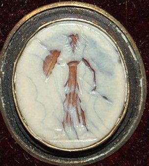 Sardonyx gem engraved with Athena advancing to the right, wearing a crested helmet and chiton and holding a spear and shield.