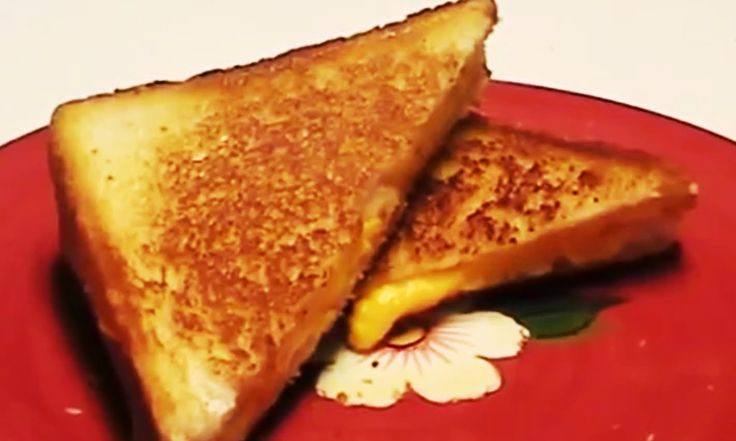 VIDEO FOOD RECIPES how to cook delicious Grilled Cheese Sandwich easy food recipes https://www.youtube.com/watch?v=jZWvayHfCKE see more video easy food recipes : http://goo.gl/aVhZqL  Ingredients 2 slices Cheddar, American, or Swiss cheese 2 slices white bread 2 tablespoons butter  Preparation  Put the cheese between the slices of bread. Heat 1 tablespoon of the butter in a skillet or grill and when melted add the sandwich. Gently press down with a spatula once or twice during the grilling…