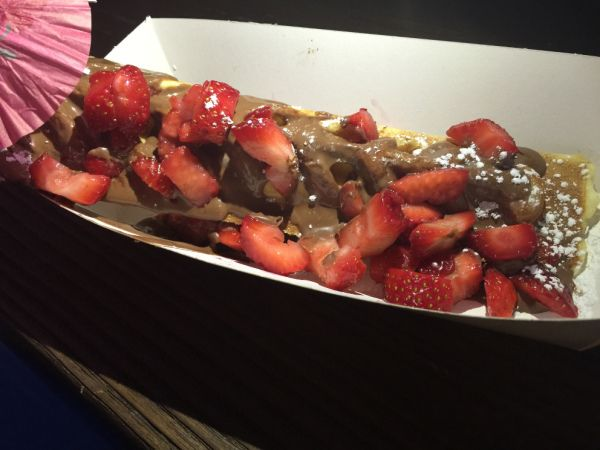 And finally, for dessert, we couldn't go past 'Waffle on a stick'. We tried the melted chocolate one and for a little extra added fresh strawberries. I was a little self conscious eating this as I was concerned chocolate was smeared all over my face. But that didn't faze our son who got stuck into it!