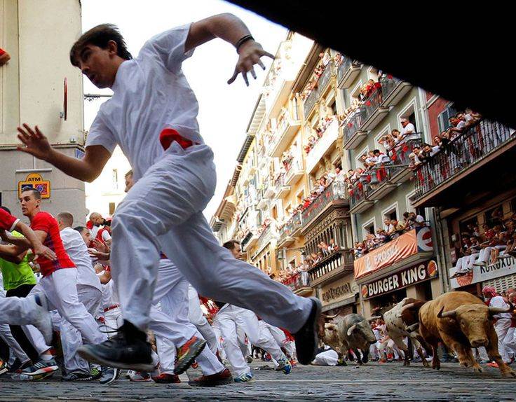 Running of the bulls: The most shocking photographs Pamplona hosts its infamous running of the bulls – part of the annual San Fermin festival – once again  -  July 7, 2017:     Runners sprint ahead of bulls during the first running of the bulls at the San Fermin festival in Pamplona