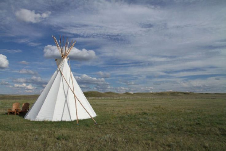 The author's tipi came equipped with cots and an impressive view of the rolling prairies.