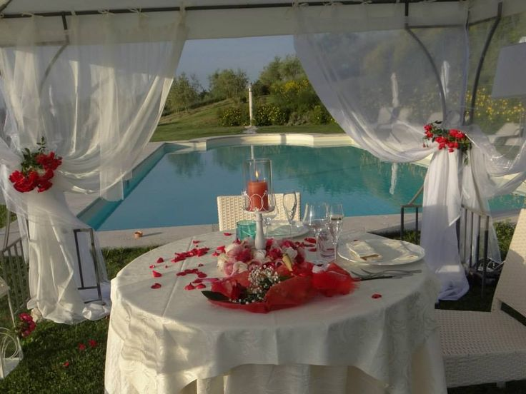 Wedding Reception in Italy in the romantic farmhouse Taverna di Bibbiano near Siena (Tuscany), with view over San Gimignano medieval towers.