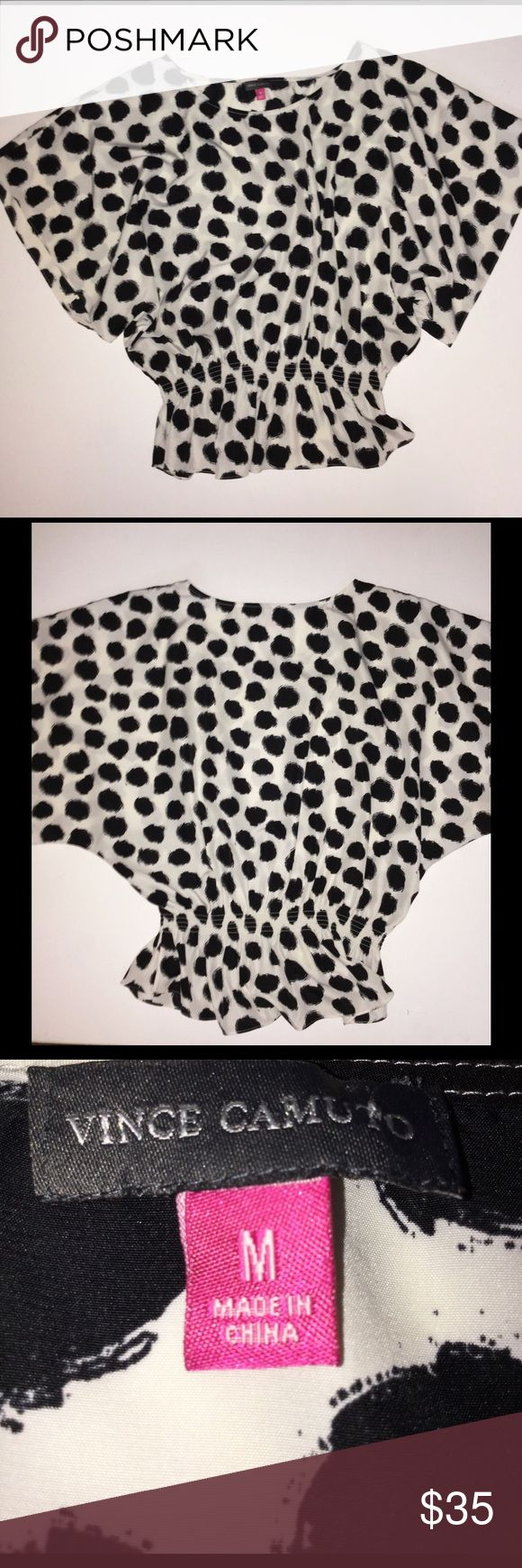 Vince Camuto Medium White and Black Batwing Top This is a white Vince Camuto Top with Black Spots. It is a size Medium. Excellent Condition. It has a rounded neck, batwing sleeves, and a tapered Peplum style waist. This would be a fantastic casual or dressy top for fall. Keywords: designer, batwing, short sleeve, draped, Peplum, Polka Dot, polkadot, polka-dot, 3/4 sleeve, work, career, job interview, Blouse, shirt Vince Camuto Tops Blouses
