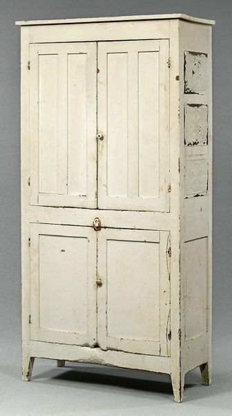Cupboard with Two Double-Frame-and-Panel Doors andThree Punched Tins with Pinwheel Decoration.