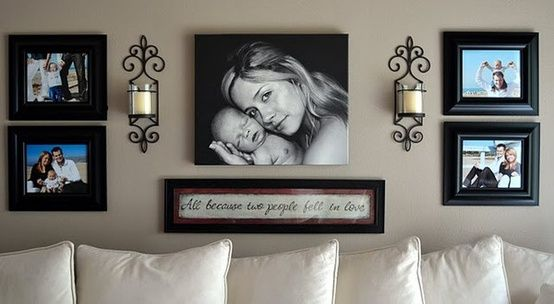 Love the mix of sconces and pictures