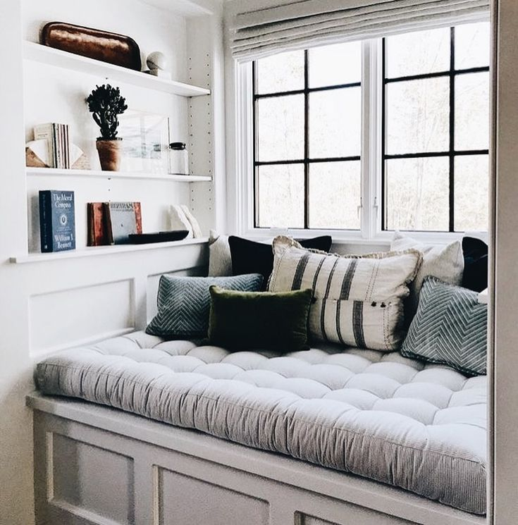 Aww I love this reading nook. It could double as hidden storage too!