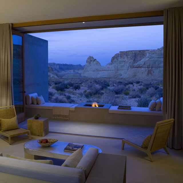 Absolutely beautiful view with a gorgeous fireplace in this hotel suite ripe with modern style