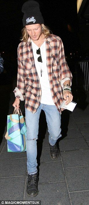 Date night: Ellie Goulding (left) and Dougie Poynter (right) arrive at the Hammersmith Apo...