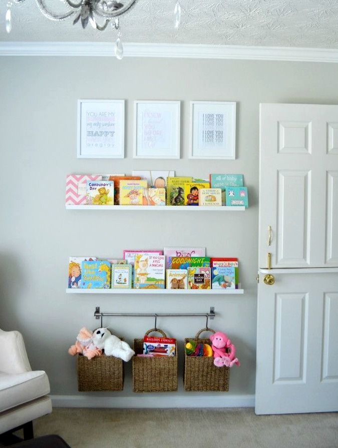 "Nursery Bookshelf Wall - with the quote ""the more you read, the more you know"" by dr. seuss at the top instead of the frames, like the storage at the bottom too"