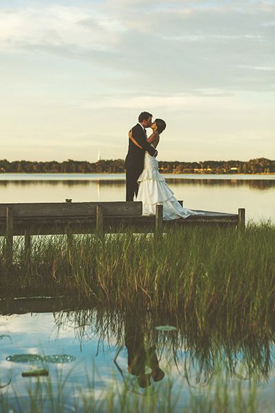 A kiss on the docks makes for a perfect summer solstice photo full of natural beauty.Related: 100 Ideas for Summer Weddings