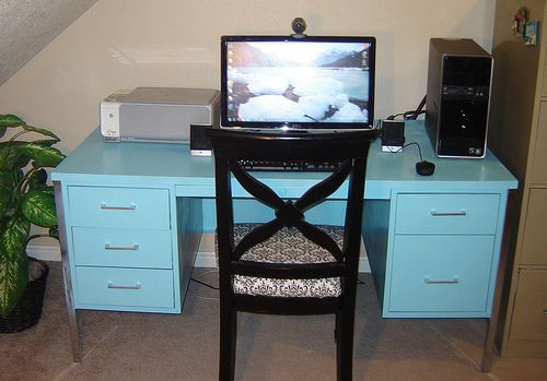 Refurbished metal desk in a pleasant spray painted color.