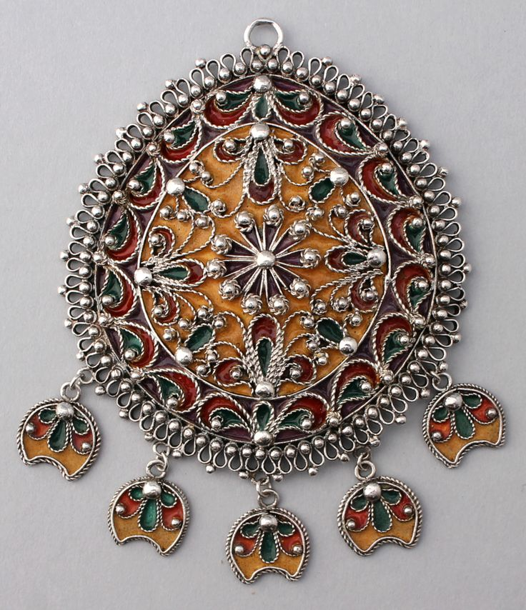 This is a very large silver pendant from Bulgaria, in high grade silver with enamel in gold, purple, green, and red colors.  Likely late 20th century, made in a revival of Bulgarian folk jewelry.