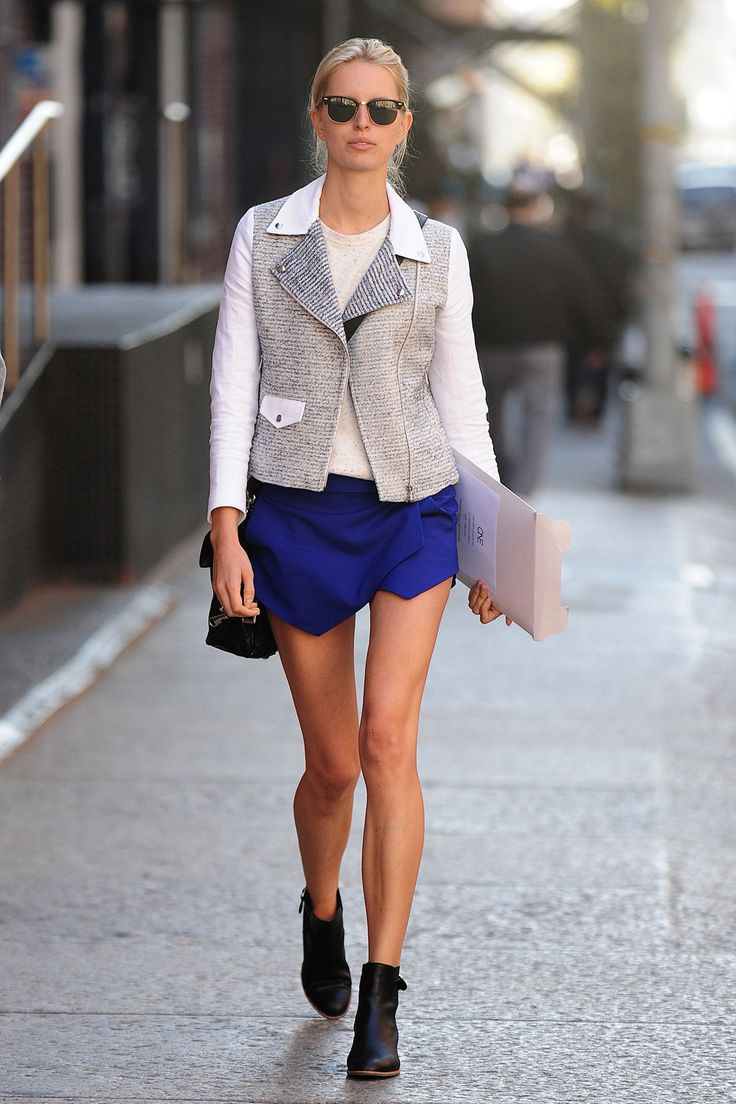 edgy yet still classic- blue layered skirt with vest and booties