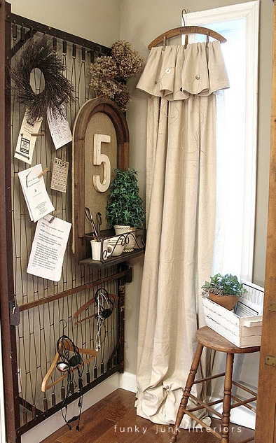 This is fabulous. Drop Cloth used as curtains, clothespinned to a wooden hanger. Mattress spring on the wall to display notes...etc. (Donna from Funky Junk Interiors gets the credit)