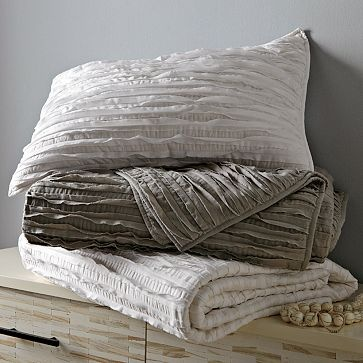 I love the Frayed-Edge Quilt + Shams on westelm.com...maybe on the foot of the bed with citron duvet (in light gray)