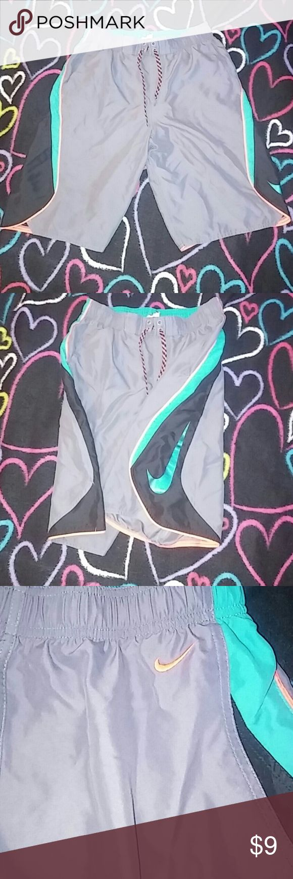 Nike Swim Trunks Great condition with everything intact. No holes or rips. Inside liner See Pic #4 for only Tag flaw. Nike Swim Swim Trunks
