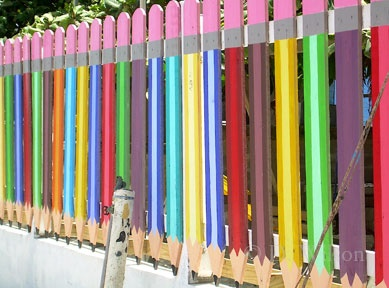 Pencil Fence:    This colorful fence, which shields a pre-school from the dusty street, is near the airport in San Pedro, Ambergris Caye.