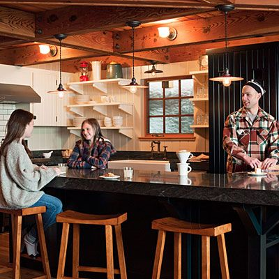 Open shelves of, dinnerware on the range side and glasses opposite!  Timeless kitchen - Lake Tahoe Cabin Makeover - Sunset