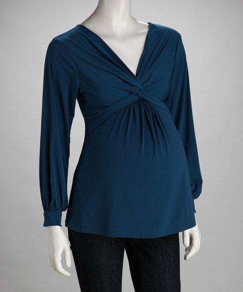 For nine months of style and more, slip into this soft, stretchy top. Featuring a classic silhouette and front knot that sits just above the belly, it'll craft an excellent ensemble for any modern mama-to-be.94% rayon / 6% spandexMachine wash; tumble dryMade in the USA