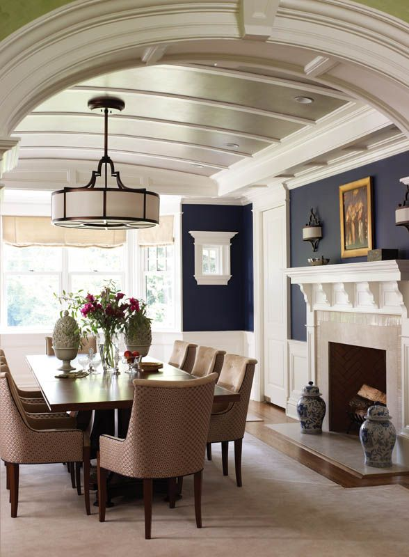 Deep blue walls and a barrel-vaulted ceiling with shimmering silver paint bring drama to the dining room. Heather McWilliam-Autore, designer