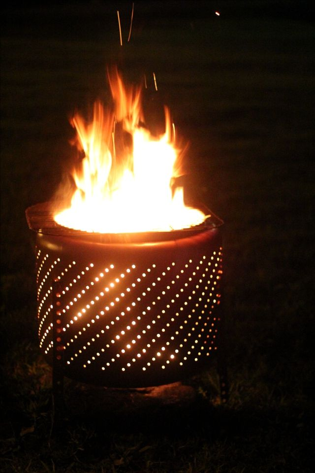 We made our own fire pit from an old washing machine drum. I have it in my back yard, not only does it look pretty the heat radiates just perfectly.