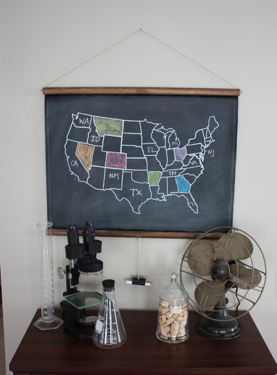 Saw this on Ohdeedoh.  Wonder if I could make it - stained dowels, some eye-hooks, chalkboard fabric...great for homeschool.