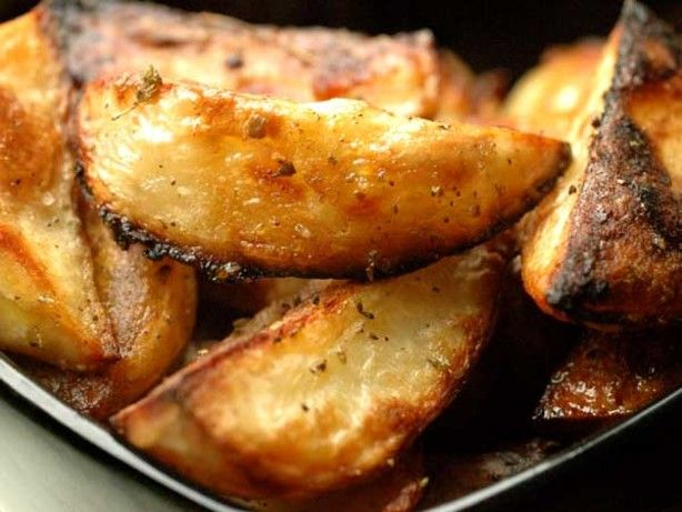 These potatoes are a staple in our home. Whether accompanying roast lamb or chicken, or just on their own, we have them a couple of times a week. They are delicious and the ones that get overly-brown in the pan and stick a bit are MINE!  Clean up is a little tricky with this recipe, unless you line your pans with foil, but I find that just filling the pan up with hot, sudsy water and forgetting for an hour (something I apparently have no problem doing ;-)) helps a lot.