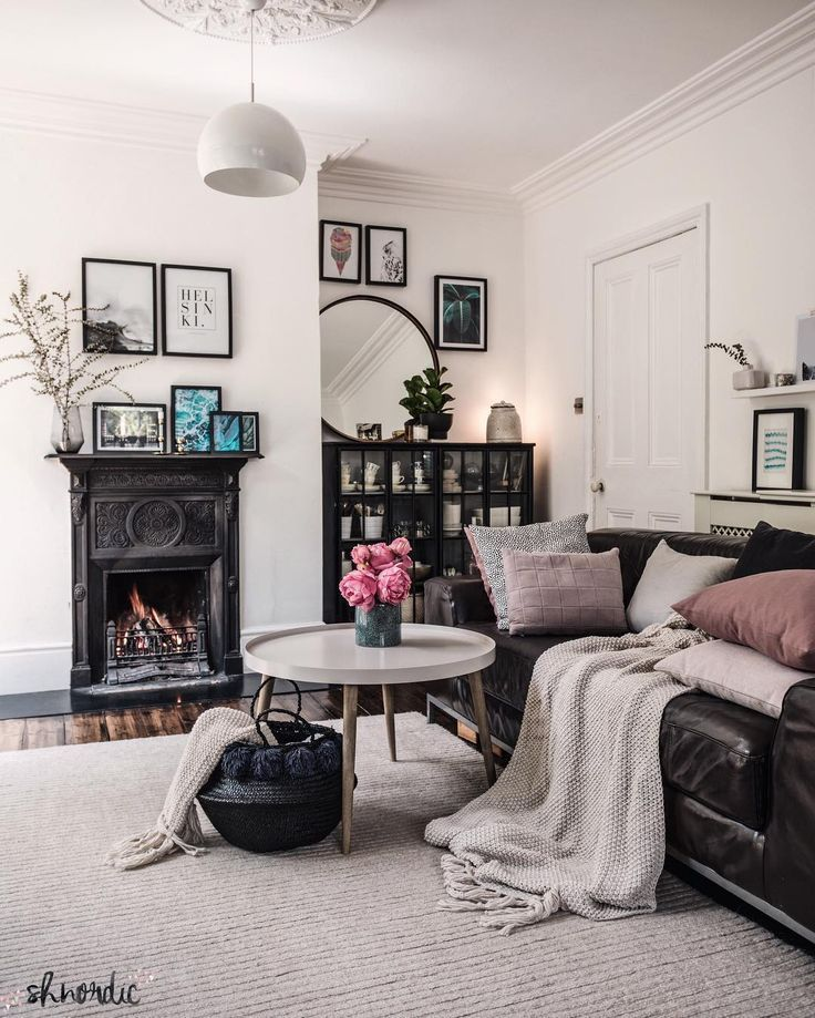 Victorian Living Room With Dark Floorboards White Walls And Cast Iron Fireplace Gallery Wall And Big Round M Victorian Living Room Home Decor Dining Room Rug