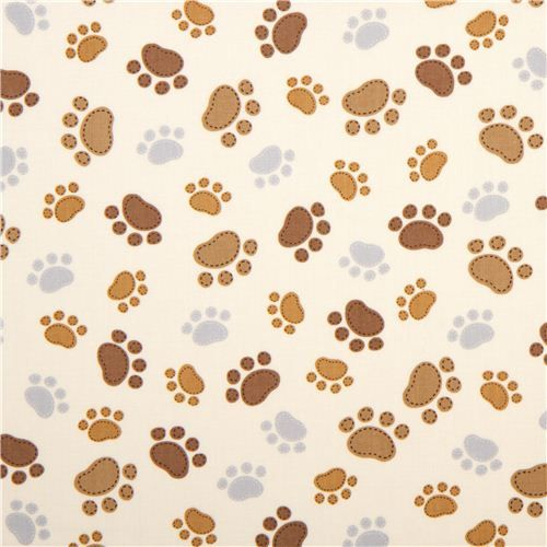 cream Timeless Treasures fabric with funny paw prints