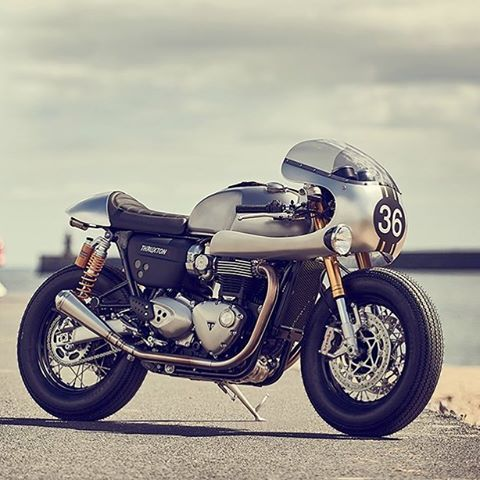 @barbourinternational, @triumphamerica , and @downandoutcaferacers dropped this little beauty a while back at this year's @bikeshedmc event but we're still fawning over it. . Yeah, yeah, the tires... but other than that little gripe about the tire choice, this Thruxton R is a gorgeous thing and has some perfectly classic lines. . #ironandair #caferacer #motorcycle #triumph #thruxtonr #thruxton #modernclassic #custommotorcycle #vintagespeed