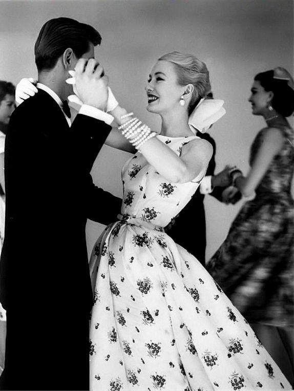 1955 Catherine McManus (Vogue fashion editor) in sleeveless embroidered print dance dress, photo by Joseph Leombruno