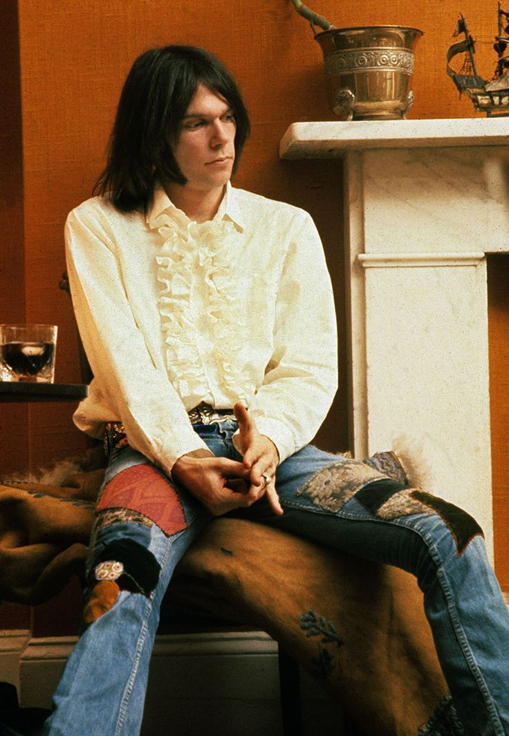 Neil Young, puffy shirt and patched jeans, 1970, by Barrie Wentzell