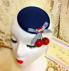 NAUTICAL BLUE CHERRY HAT    eBay UK 17 Navy woollen base, 10cm diameter, trimmed with luxurious velvet & contrasting Royal Blue stitching adorned with a blue candy striped bow, centered with a red velvet Love Tattoo Heart & finished with two glossy Cherries