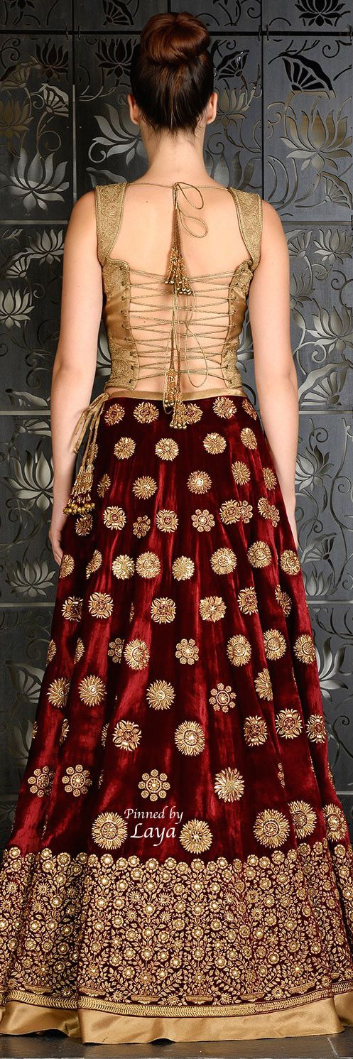 Traditional Indian bridal red and gold lehenga and blouse. Bridal fashion.