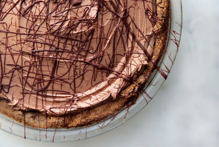 Hosting vegan guests this holiday season? No need to serve them a separate dessert. Whip up this silky chocolate pie at the holidays, and all of your guests—even your vegan and gluten-free ones—will be able to enjoy it (and trust us, they'll devour it). The press-in crust couldn't be easier—just dump the almond-based mix into your pie pan and press it to the edges. As it bakes, you can make the creamy chocolate filling, which firms up in the fridge until you're ready to eat. To serve, top…