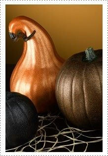 spray painted pumpkins  Several small pumpkins or gourds  (1) can Krylon Indoor/Outdoor Primer  (2) cans Krylon Glitter Blast Paint in desired colors  Masking tape  Drop cloth