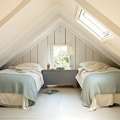 Pretty loft bedroom is a great use of space.