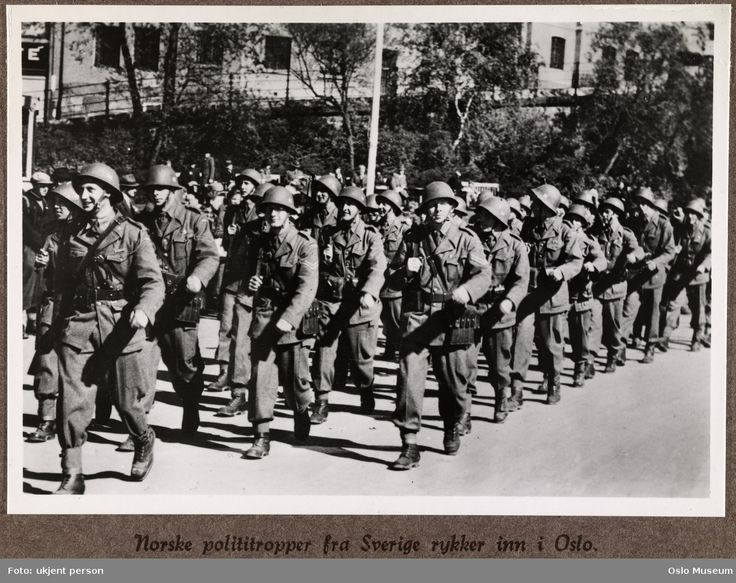 """May 1945. Norwegian infantry trained and armed in neutral Sweden during the war entering liberated Oslo. The Swedes insisted that they were merely educating a """"police force"""" for the many Norwegian refugees."""