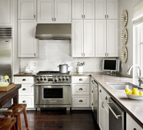 Concrete countertops, cup pulls, white cabinets, dark woods