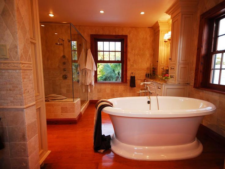 This Large Transitional Bath Is A Relaxing Retreat Thanks To The Large Freestanding Tub And A Glass Enclosed Walk In Shower Extensive Neutral Tile And
