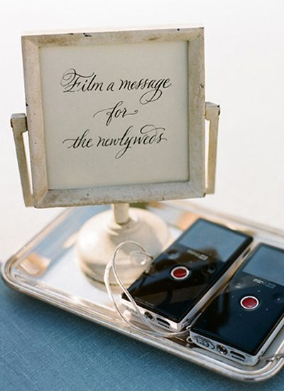 Instead of having a traditional guest book, set up a video station where guests can record their well wishes for you!: