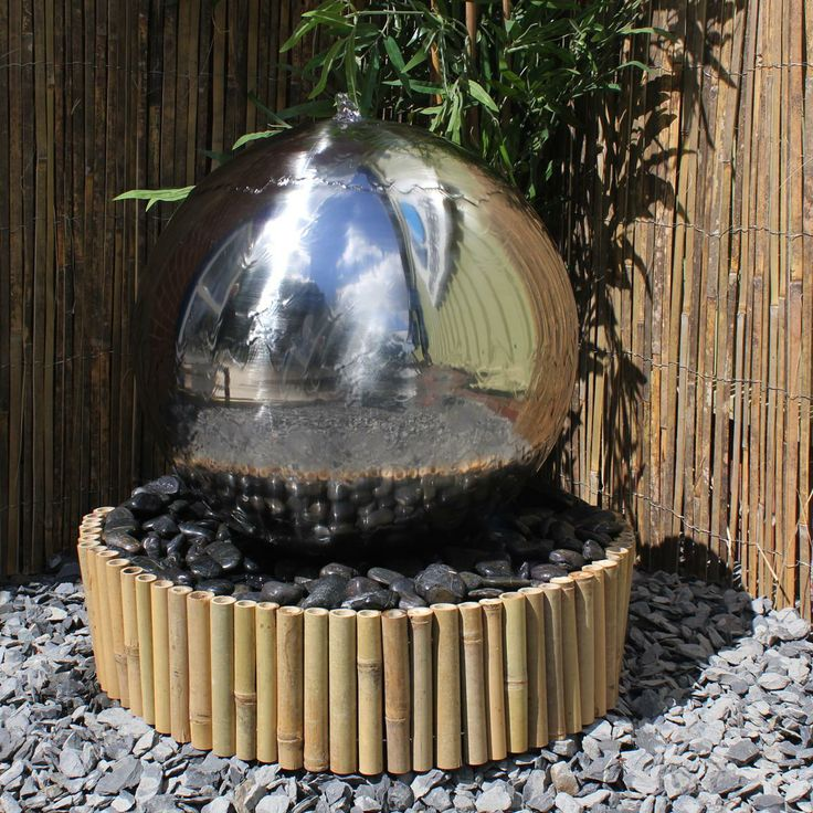 50cm sphere stainless steel water feature surrounded