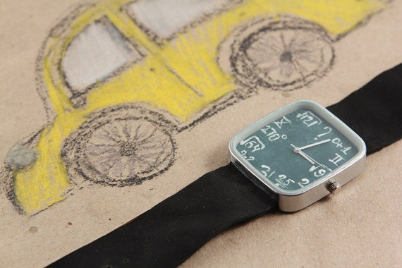 Unique watch with mathematical formulas on a blackboard. A great way to get away from the usual course of time.