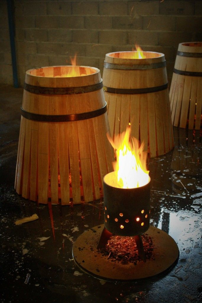 Wet staves of new barrique casks being heated over an open flame to aid lamination (bending). Courvoisier cognac cooperage - authors own image.