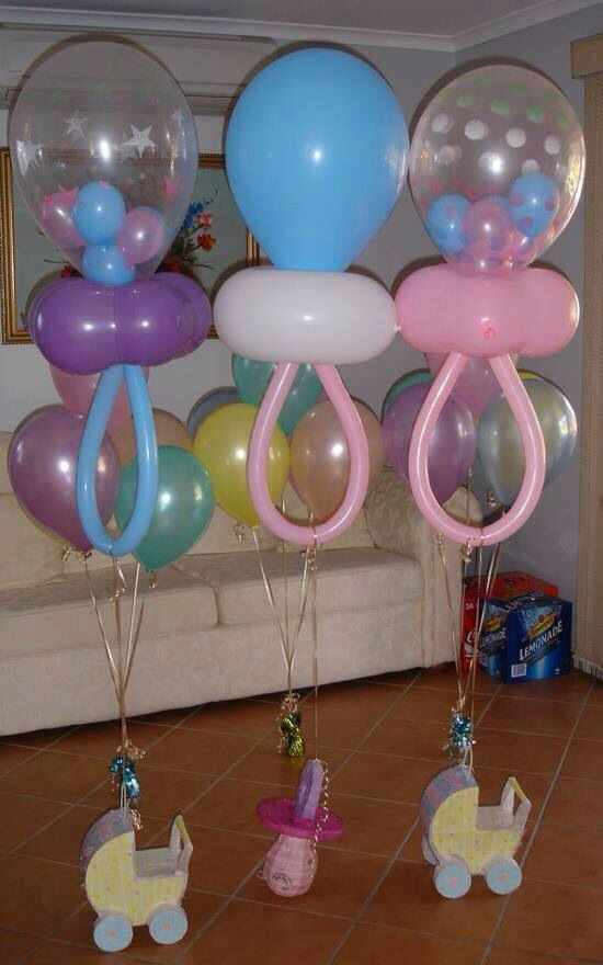 Baby shower decorations. Pacifier shaped balloons for center pieces