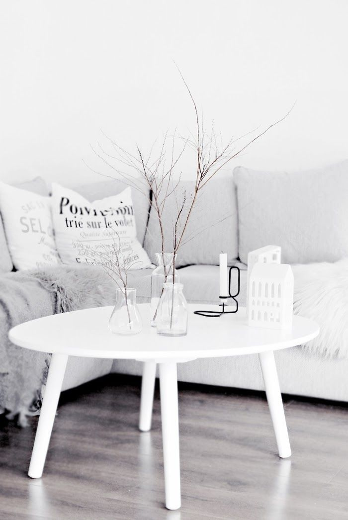 round, white coffee table - maybe for the sunroom? - RM